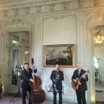 Jazz swing band of sax, guitar and bass being filmed in a beautiful room in Mayfair, London